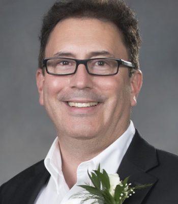 Adrian Legin, President & CEO for Coastal Community Credit Union